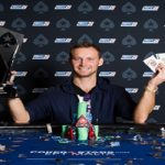 Aliaksei Boika of Belarus lifts the trophy of EPT Malta Main event